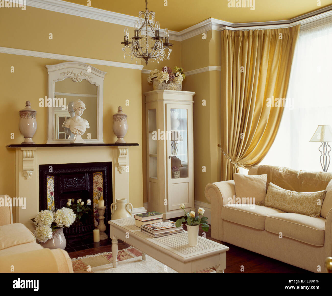 Cream sofa in front of window with cream curtains in straw