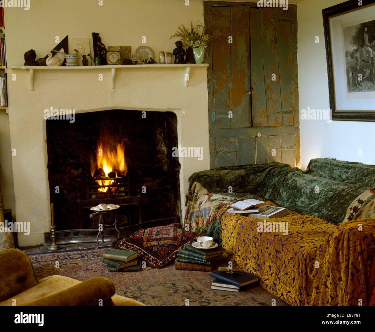Cottage Living Room With Fireplace brown and grey velvet throws on sofa beside fireplace in economy