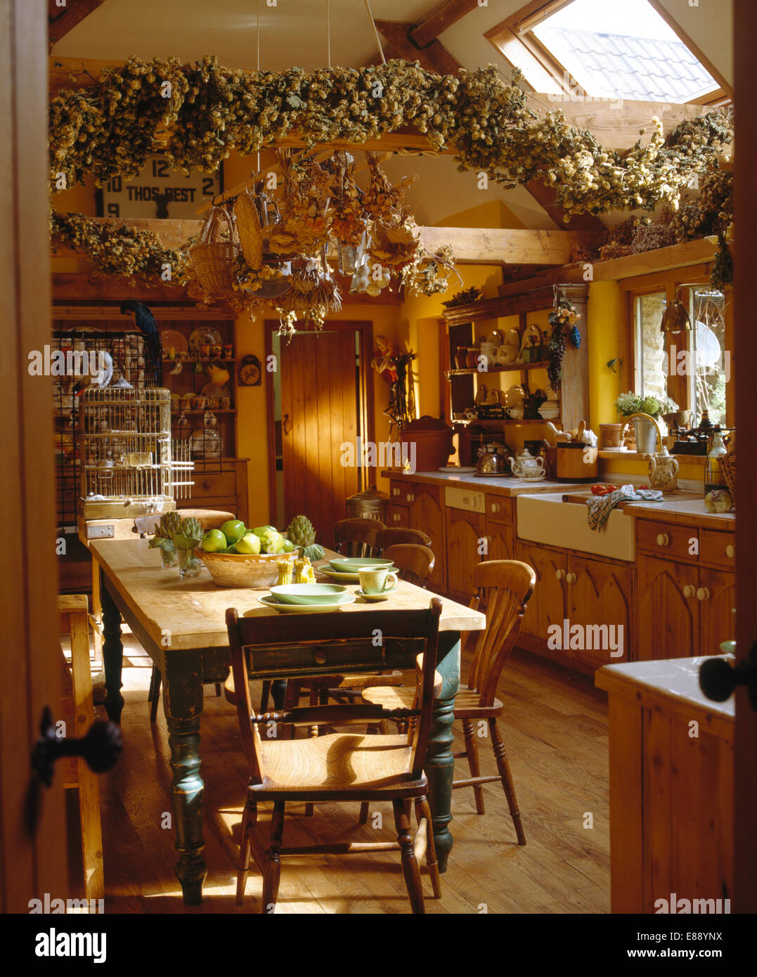 old pine table and chairs in country kitchen with hop bine garland
