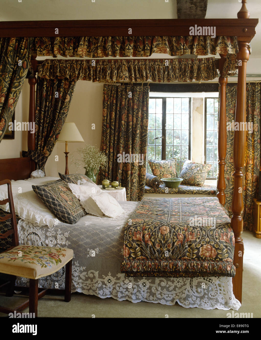 William Morris drapes on four poster bed with lace bed
