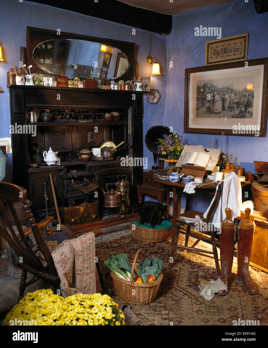 Old Victorian Range In Old Fashioned Blue Kitchen With Basket Of Vegetables  And Old Riding Boots