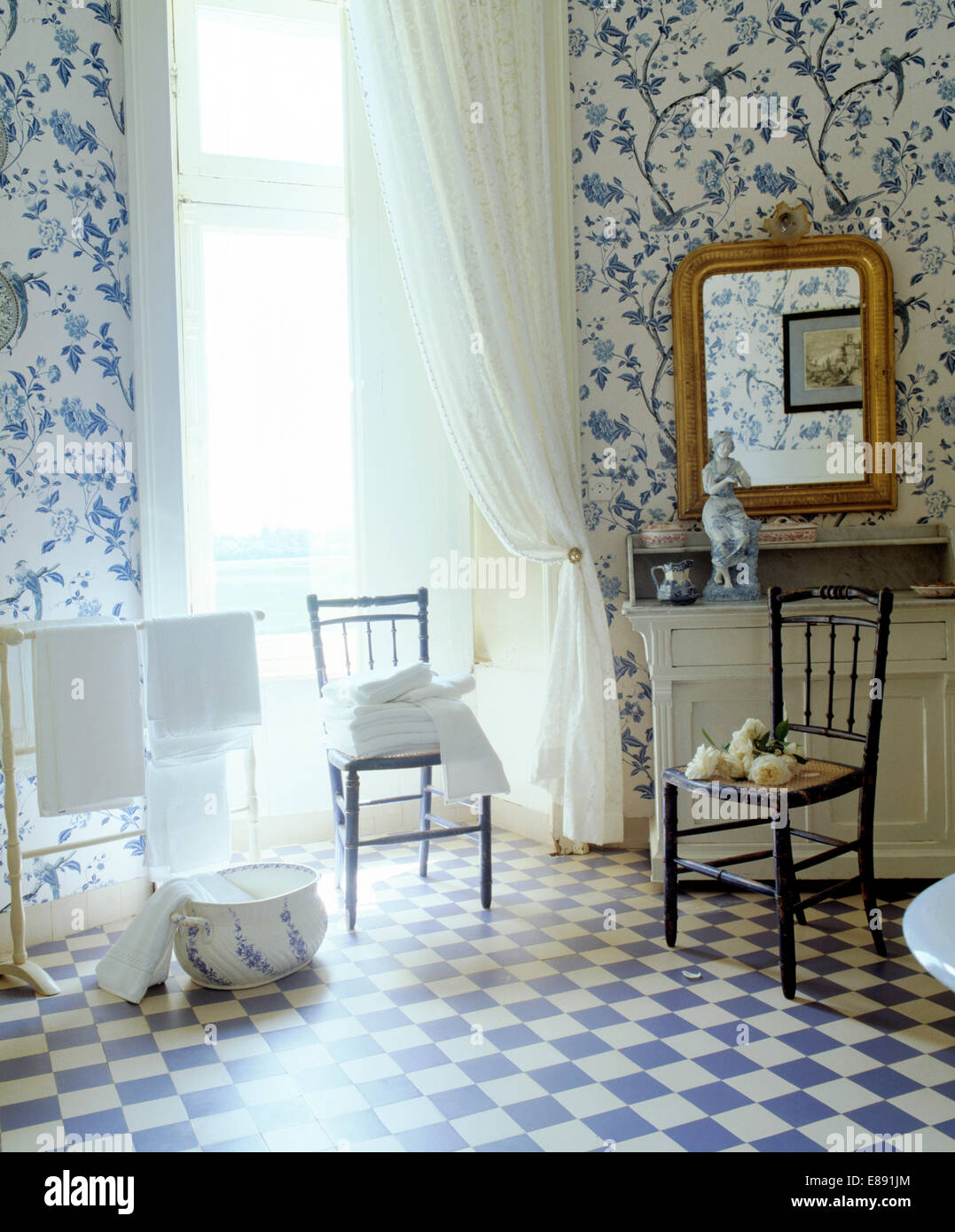 bluewhite vinyl floor in country bathroom with bluewhite floral wallpaper and white voile curtains