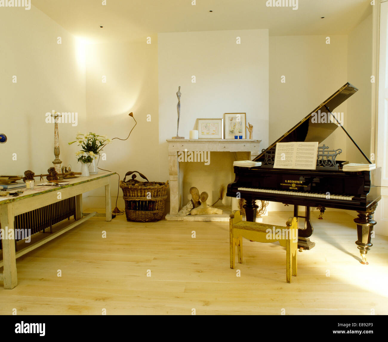 Empty room with chair violin and sheet music on floor photograph - Grand Piano And Wooden Flooring In Music Room With Painted Dining Rable Stock Image
