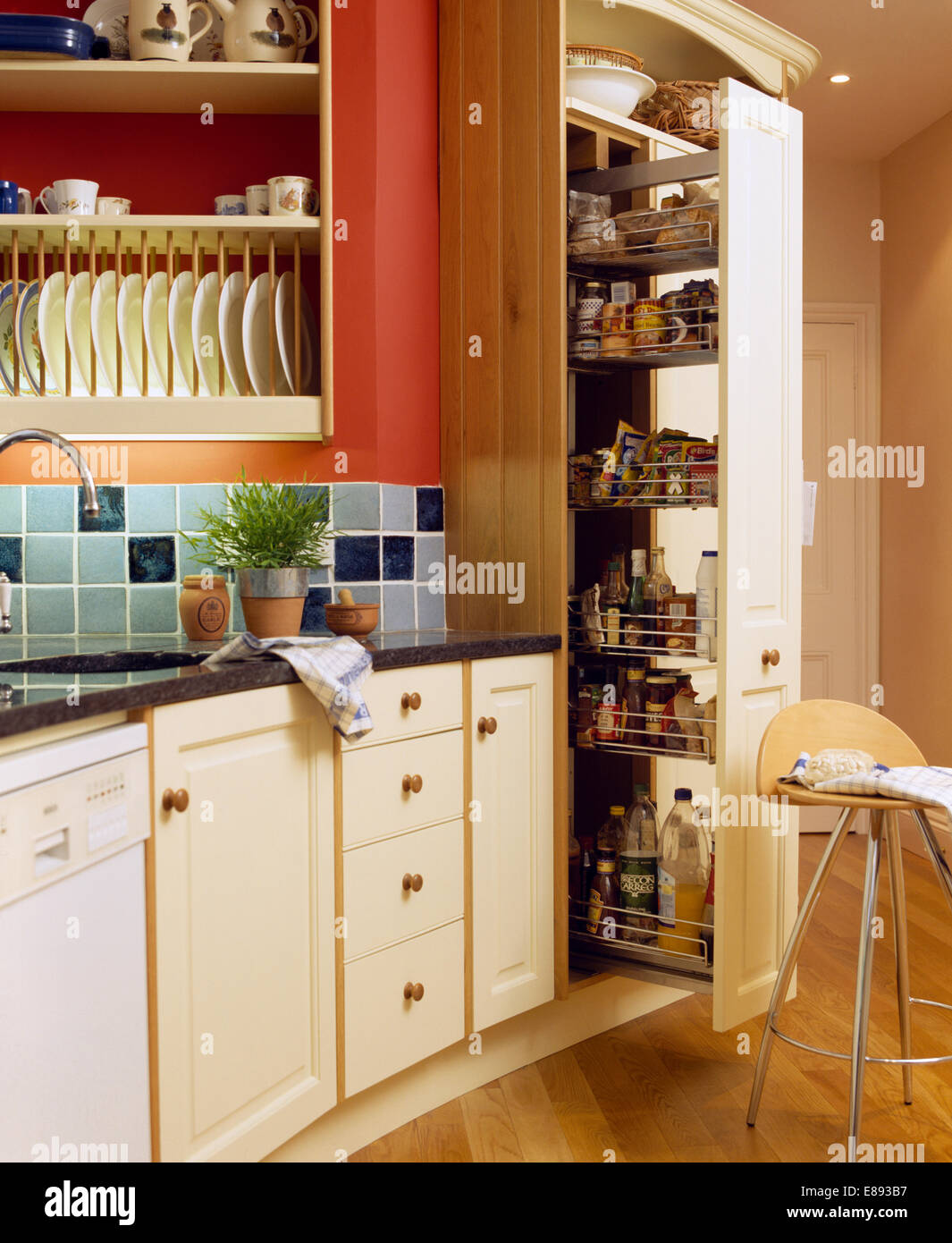 Pull Out Storage Drawers In Larder Cupboard In Kitchen With Blue Tiled  Splashback Below Plate Rack