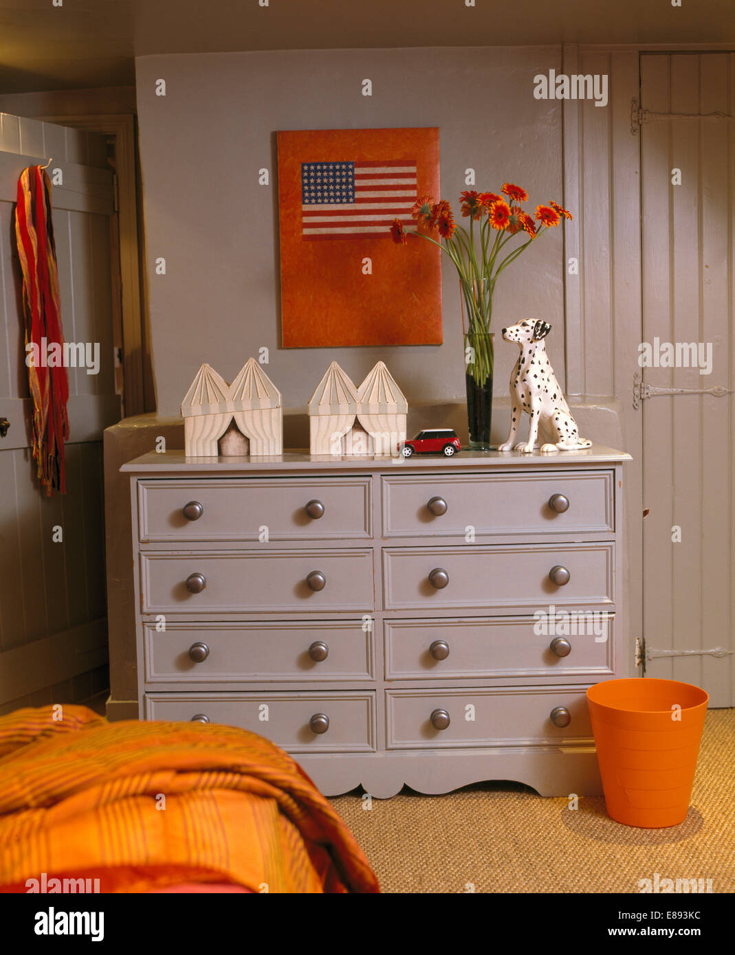 Orange And Grey Bedroom Picture On Wall Above Pale Grey Painted Chest Of Drawers In Pale