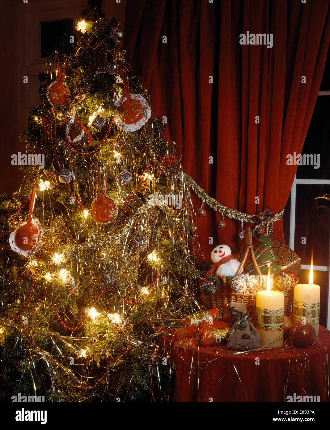 christmas tree decorated with tinsel and lametta and home made fabric stock photo royalty free. Black Bedroom Furniture Sets. Home Design Ideas