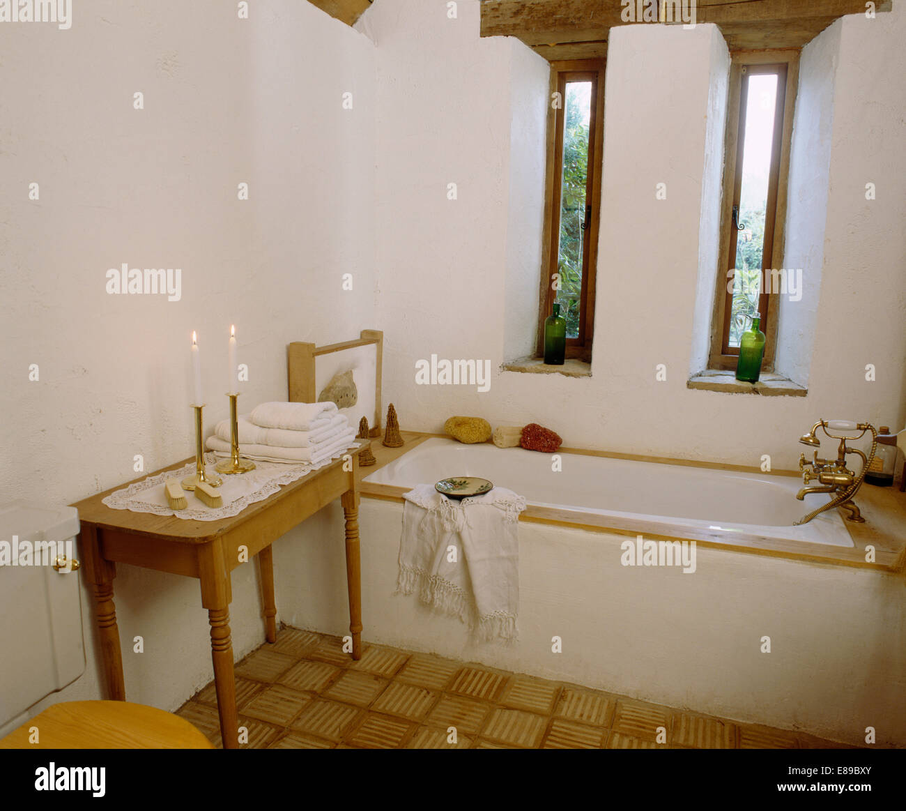 Narrow Windows Above Bath In Barn Conversion Bathroom With Lighted - Candles for bathroom