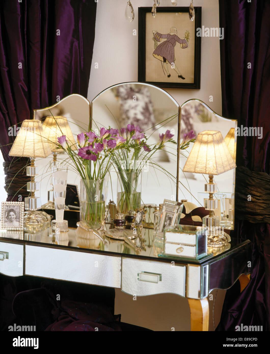 Vase of purple flowers on mirrored dressing table with lighted vase of purple flowers on mirrored dressing table with lighted lamps reviewsmspy