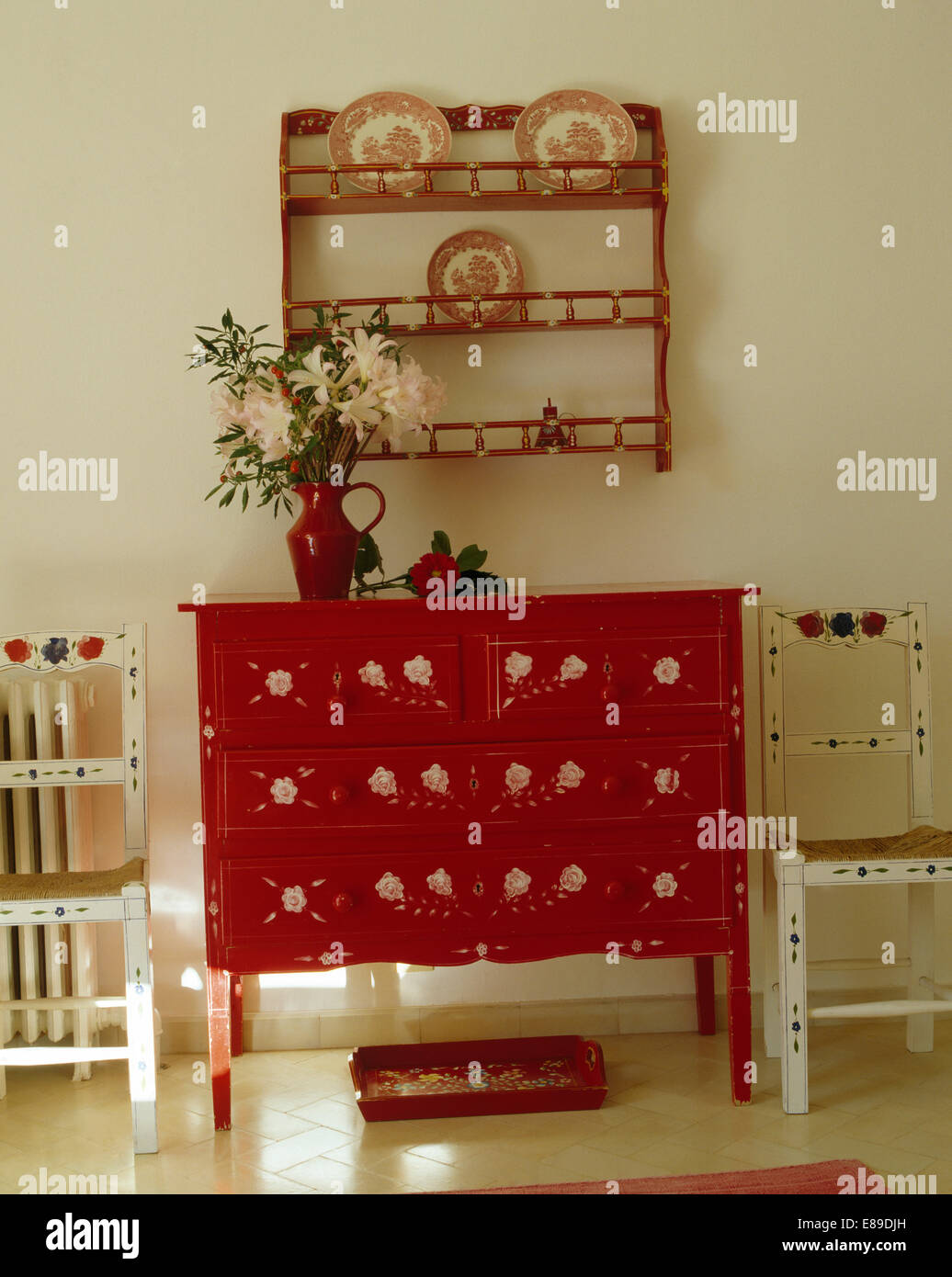 Red Painted Chest Of Drawers And White Painted Chairs Below Small