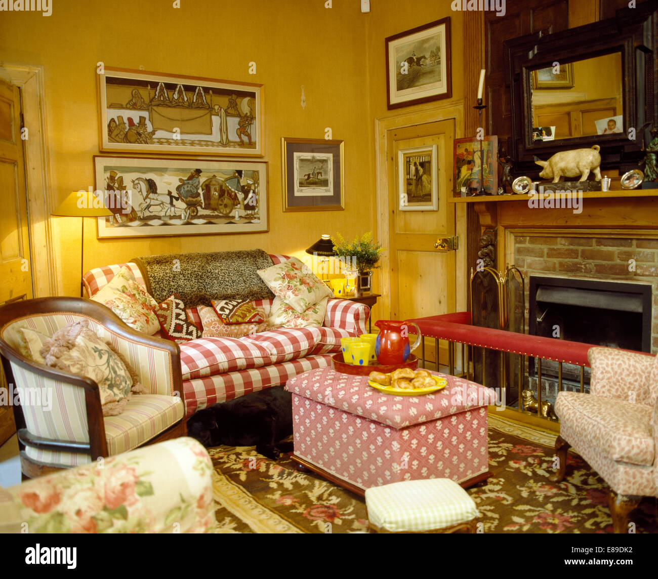 Amazing Pictures Above Red Striped Sofa In Country Living Room With Pink Ottoman In  Front Of Fireplace