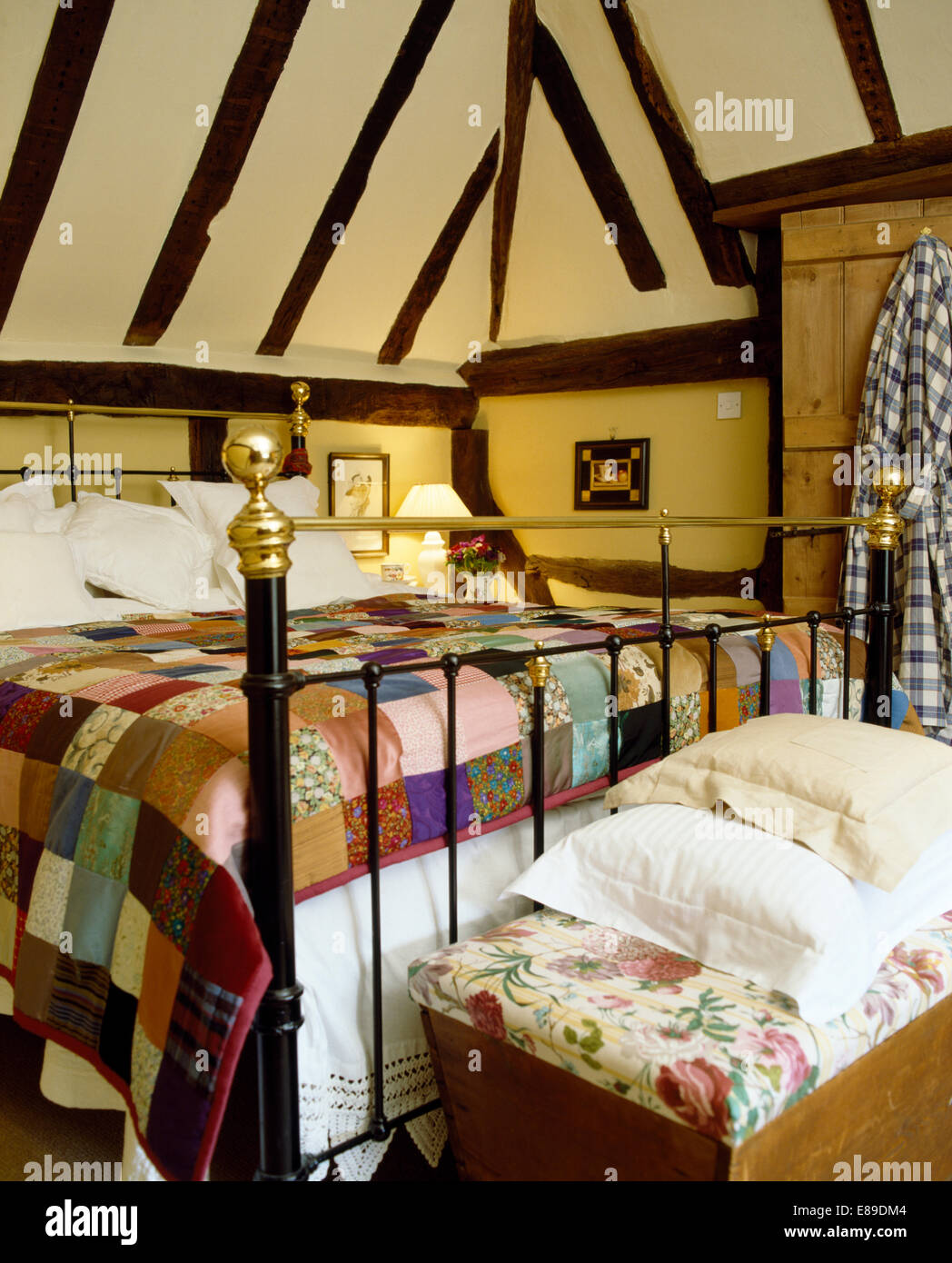 Colourful patchwork quilt on antique brass bed in cottage bedroom ... : colourful patchwork quilt - Adamdwight.com