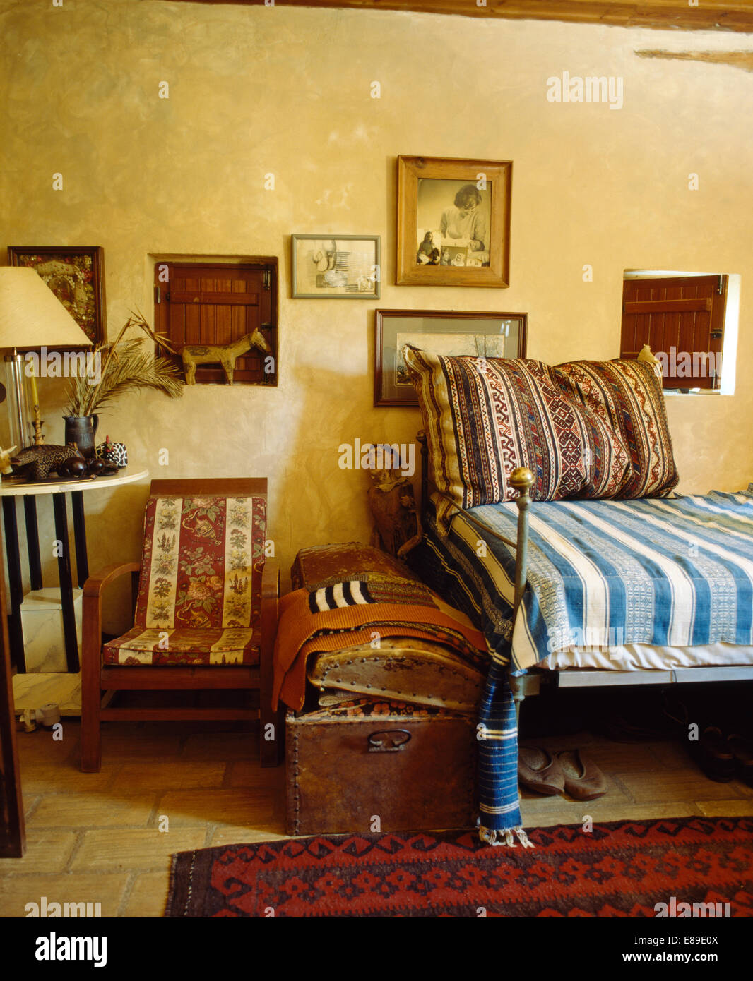 Old wooden chair styles - Stock Photo Vintage Wooden Chair And Old Wooden Chest In Ethnic Style Country Bedroom With Blue Striped Bed Cover