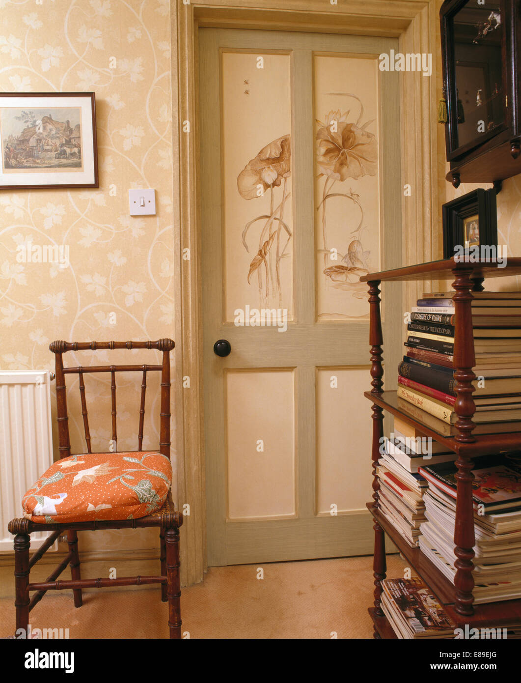 Old Wooden Chair And Antique Book Shelves On Landing With Hand Painted  Floral Decoration And Painted Door