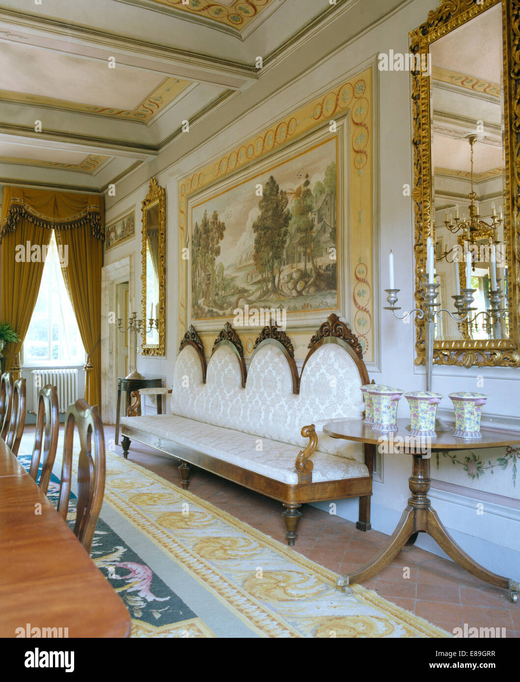 Large mural on wall above antique italian sofa in opulent tuscan large mural on wall above antique italian sofa in opulent tuscan dining room with antique mirror and small table amipublicfo Image collections