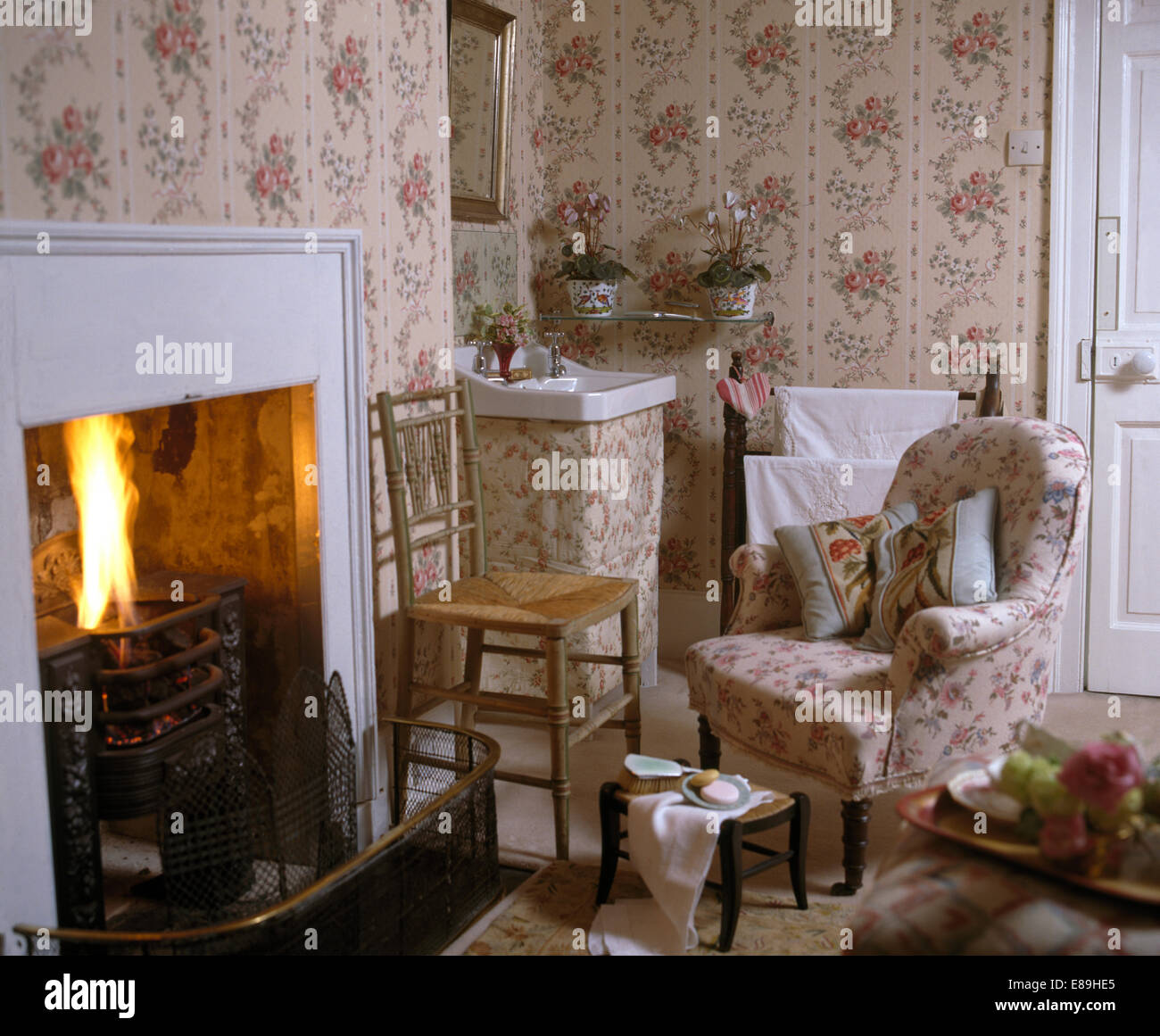Rose Sprigged Wallpaper And Armchair In Country Bedroom