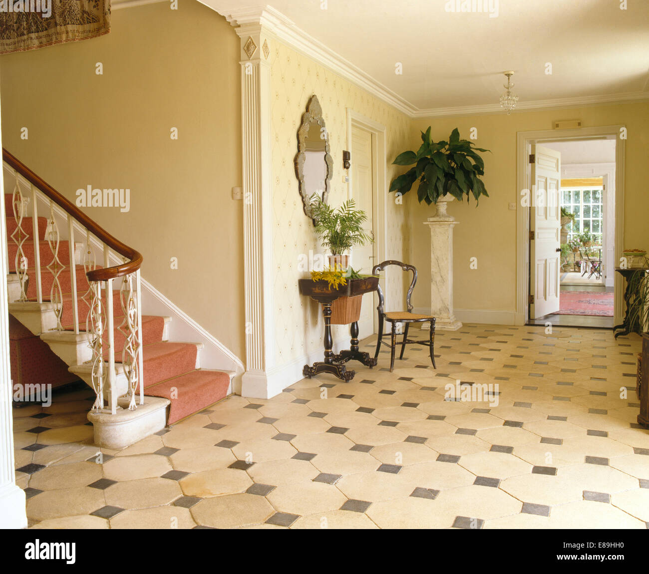Black+white Tiled Floor In Large Country Hall With Boston Fern On Plinth  And Staircase