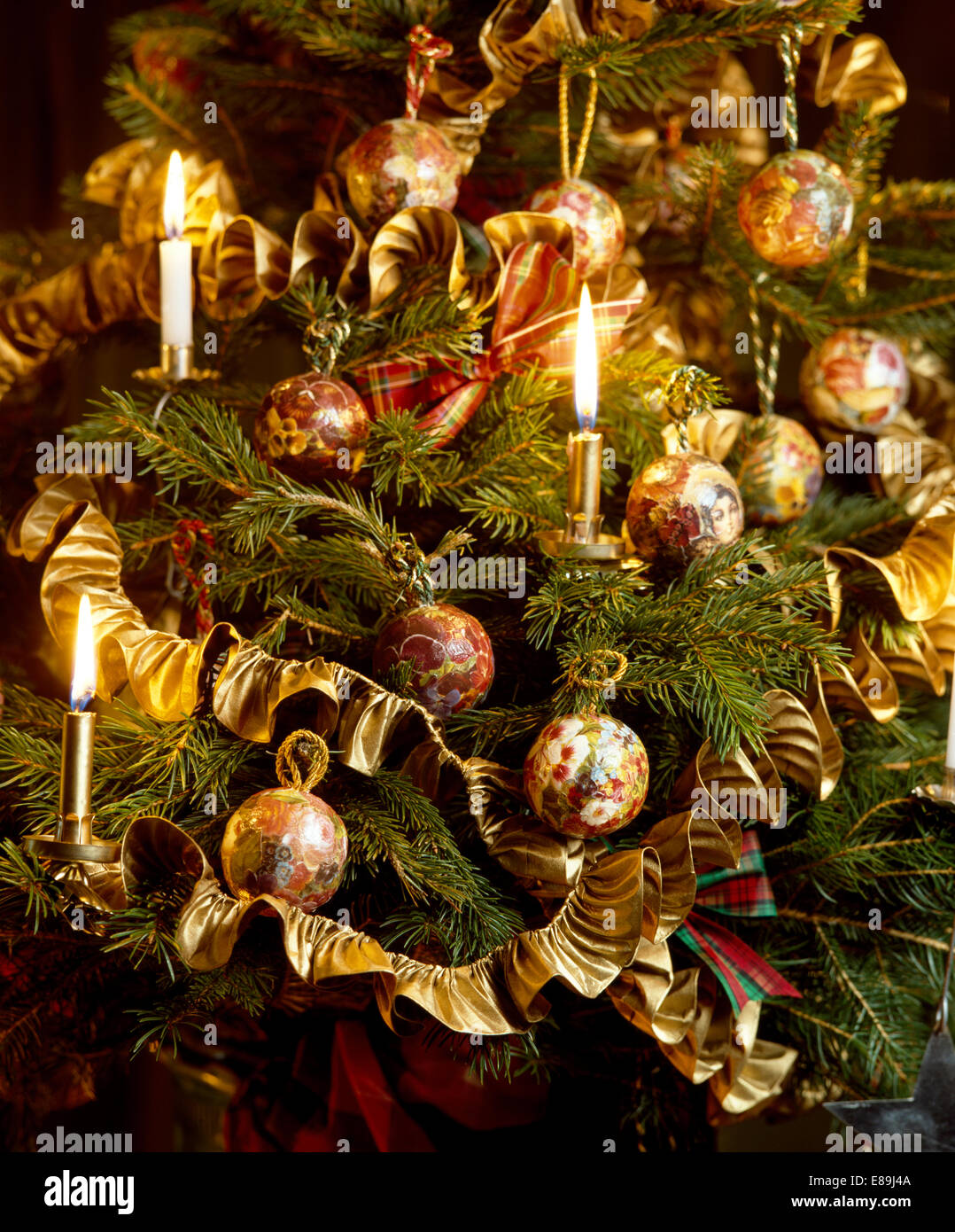 Still life of christmas tree with lighted candles and gold ribbon stock photo royalty free - Appealing christmas led candles for christmas decorations ...