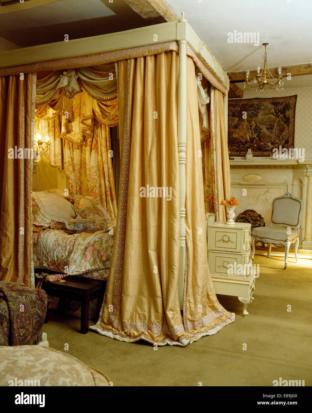 Opulent cream silk drapes on four poster bed in countgry bedroom stock photo royalty free image - Four poster bed curtains ...