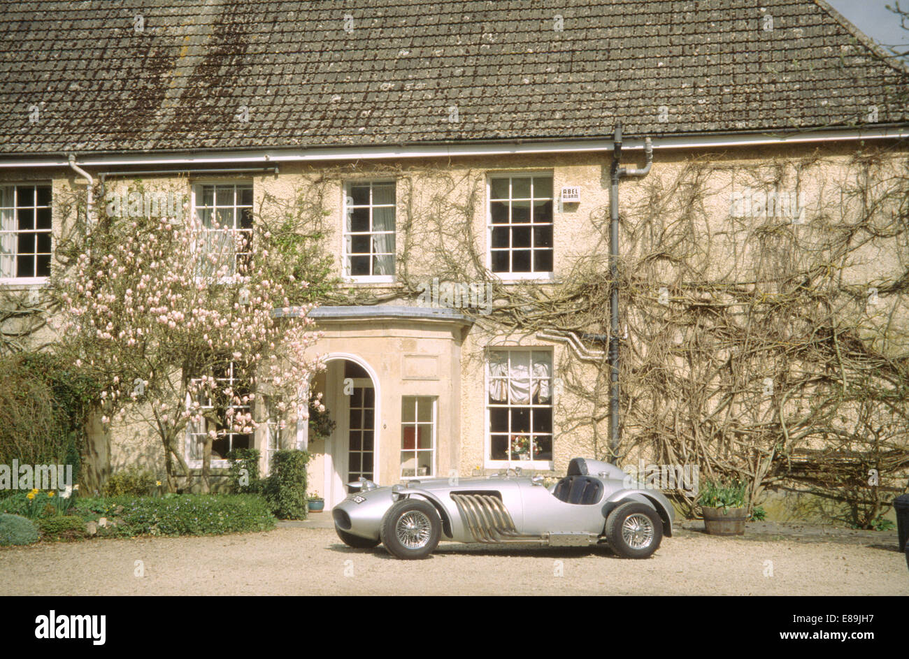 Grey Vintage Sports Car On Driveway Of Large Country House Stock - Vintage country house