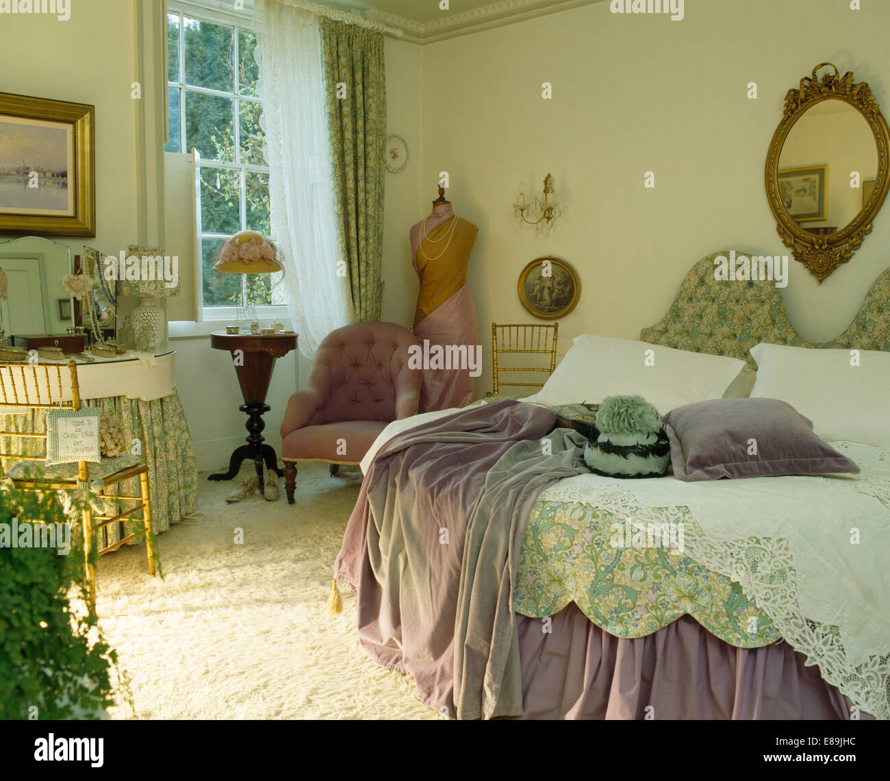 mauve throw on bed with pale green quilt and lace bedcover in