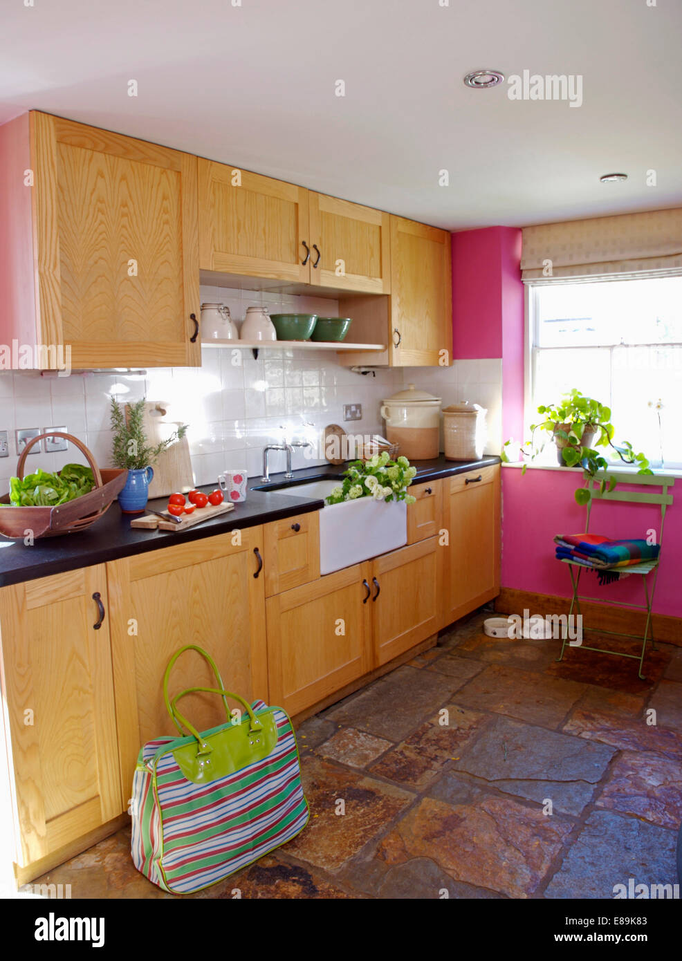 All Pink Kitchen Greenstriped Holdall On Stoneflagged Floor In Pink Kitchen With