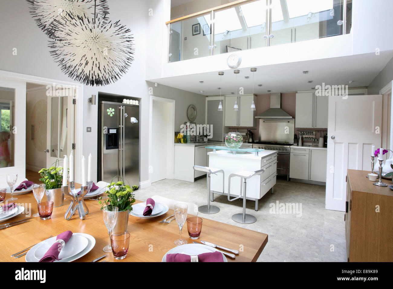 Modern Pendant Lighting Above Table Set For Lunch In Large Modern Kitchen  And Dining Room Extension