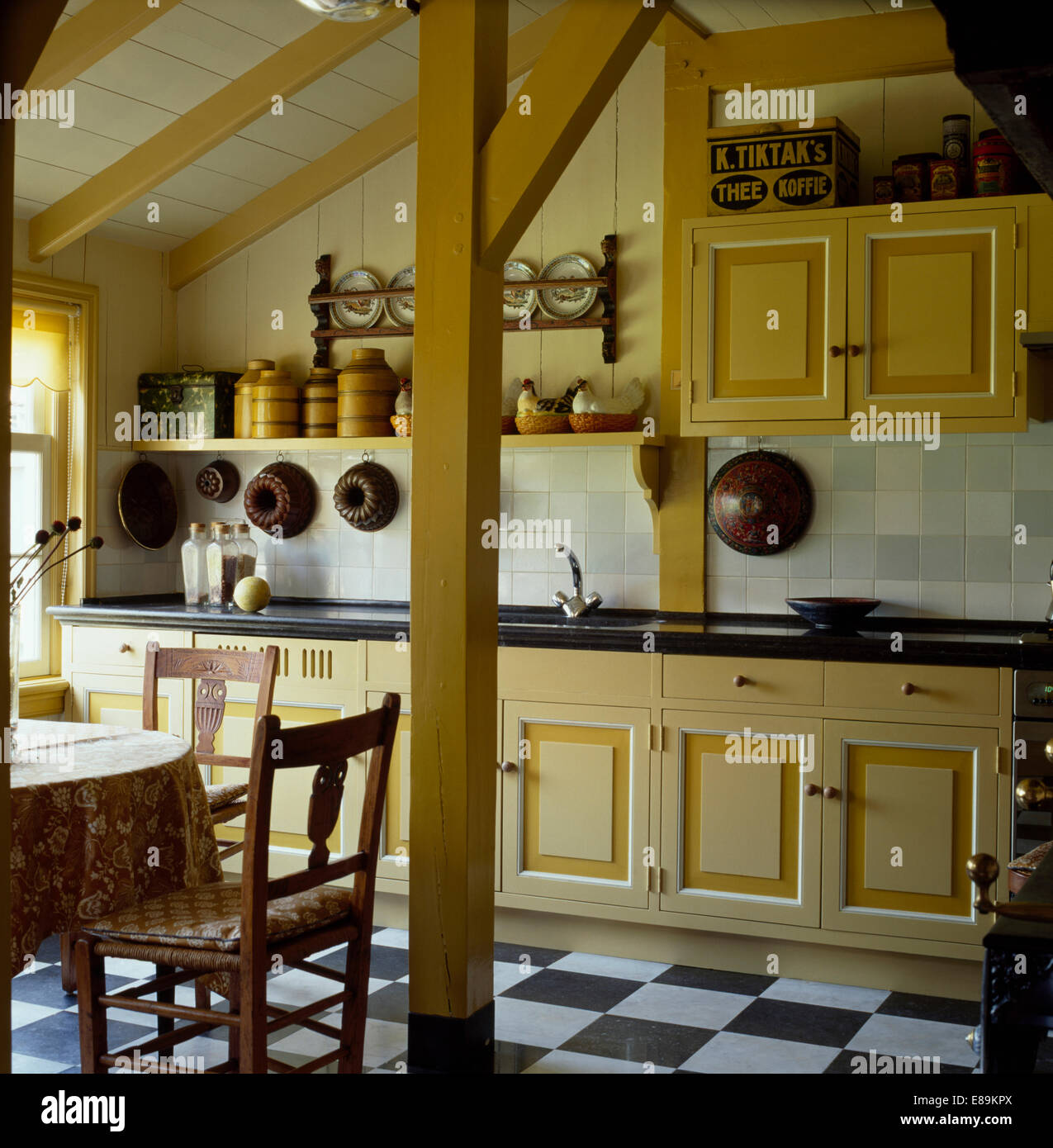 Barn Conversion Kitchens pale yellow fitted units in small barn conversion kitchen with