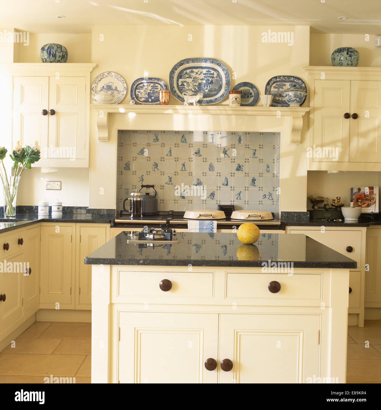 Granite Topped Island Unit In Cream Country Kitchen With Collection Blue White Plates On