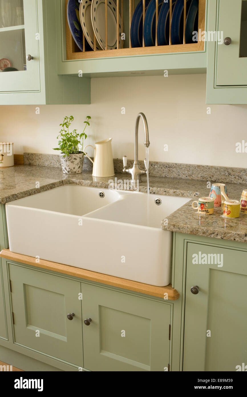 Green country kitchen - Chrome Tap Above Double Belfast Sink In Pale Green Units In Country Kitchen