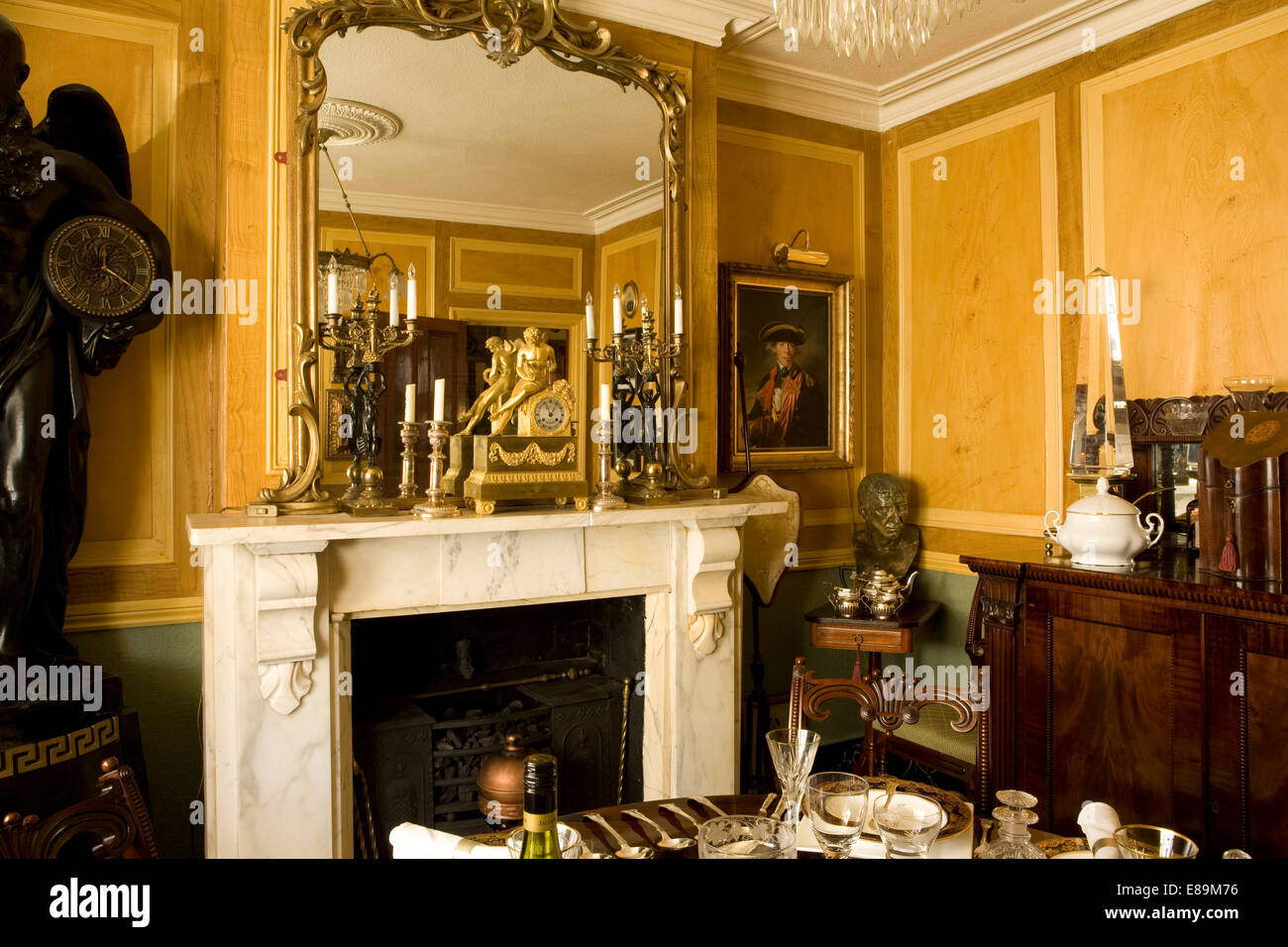 Ornate Mirror Above Fireplace In Traditional Country House Dining Room