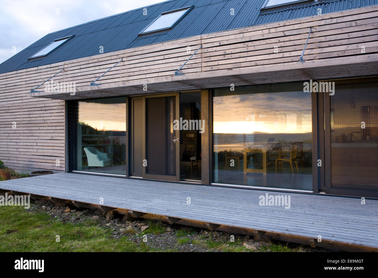 exterior of modern wooden house with decked terrace and