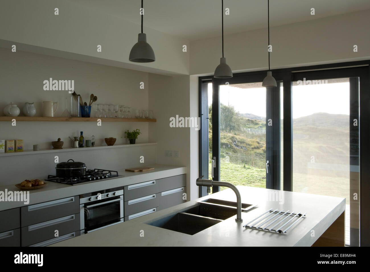 Double Sink In Central Island Unit In Modern Kitchen Stock Photo 73972448 Alamy