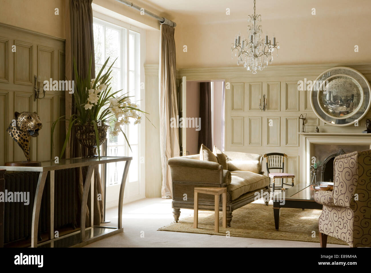Cream sofa and modern console table in pale grey panelled country cream sofa and modern console table in pale grey panelled country sitting room geotapseo Images