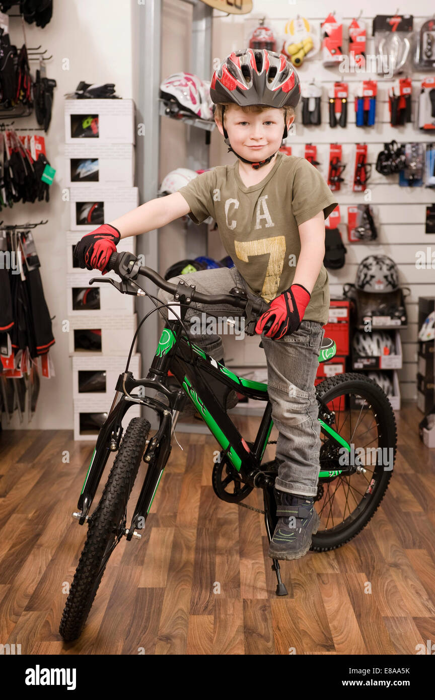 Bike Helmet Shop Boy with bicycle helmet in