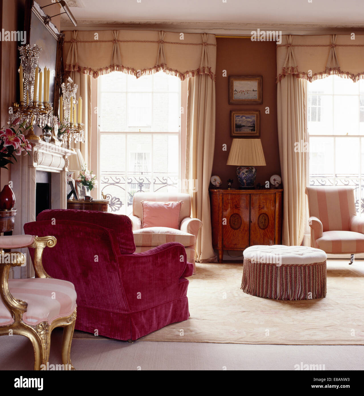 Attractive Pink Velvet Upholstered Armchair In Elegant Townhouse Living Room With  Cream Drapes And Pelmets On Windows