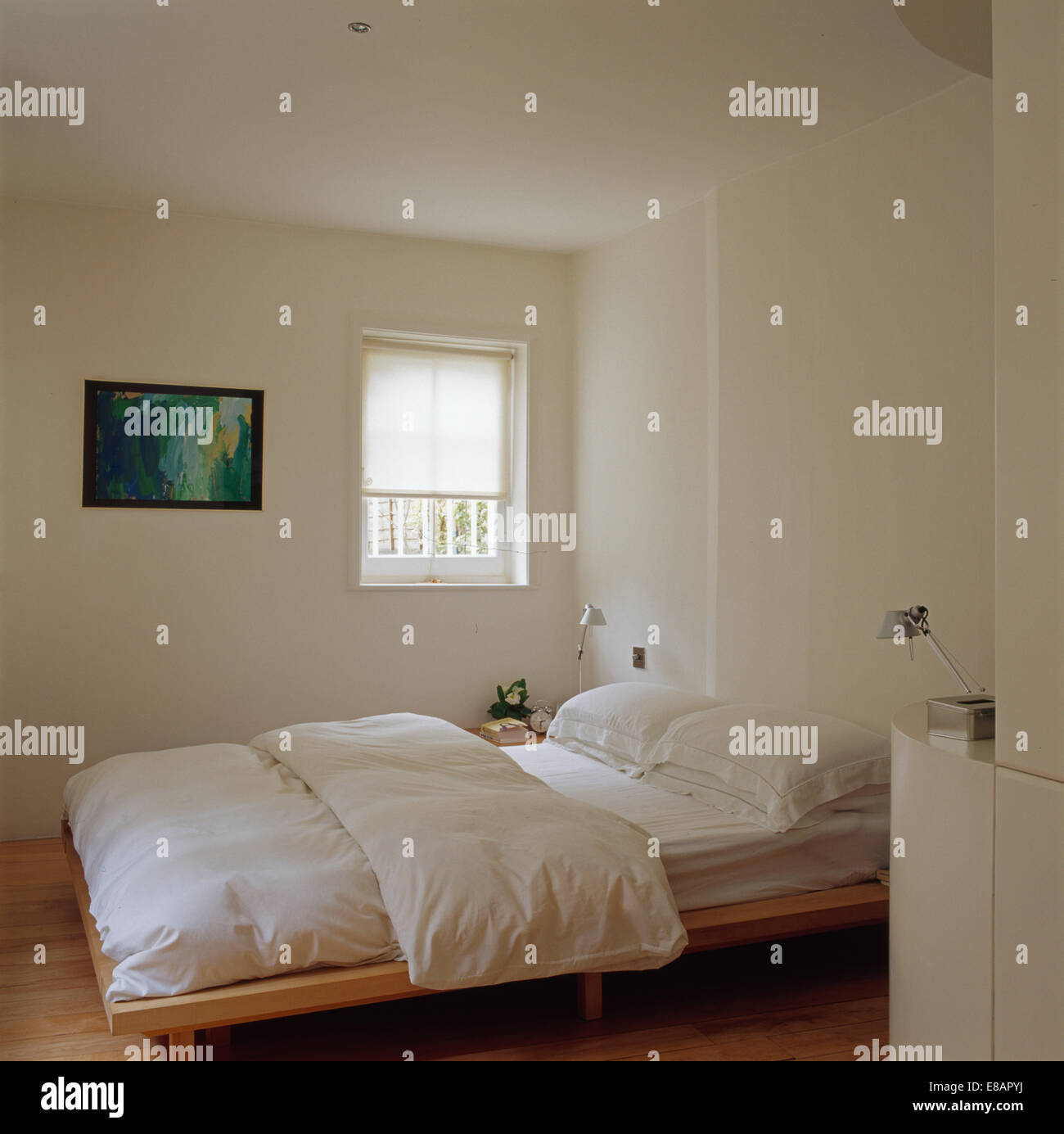 Plain white quilt and pillows on simple wooden bed in modern white ... : plain white quilt - Adamdwight.com