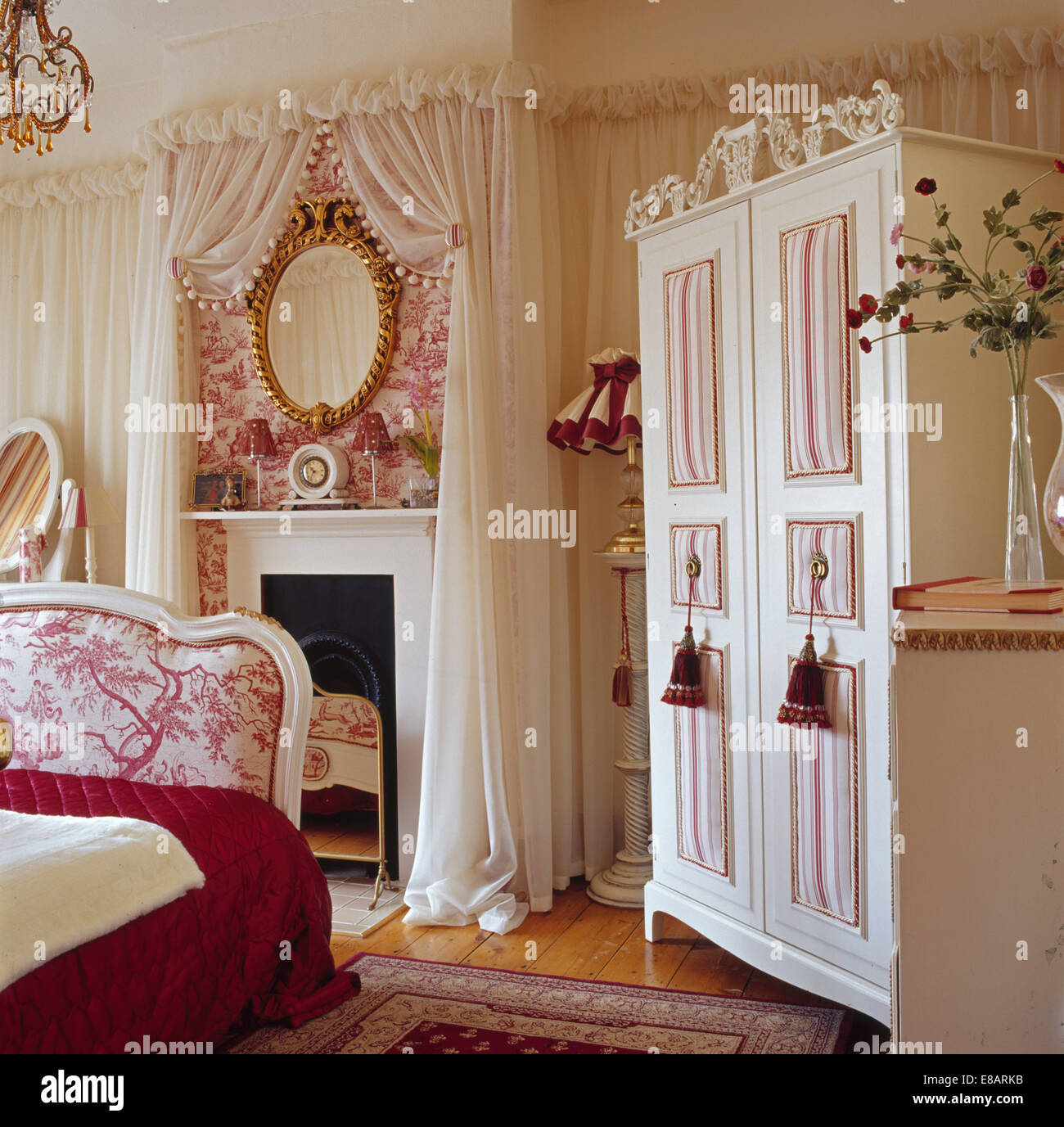Cream Wardrobe In Bedroom With Cream Voile Drapes On Walls And Toile De Jouy  Wallpaper Above Fireplace
