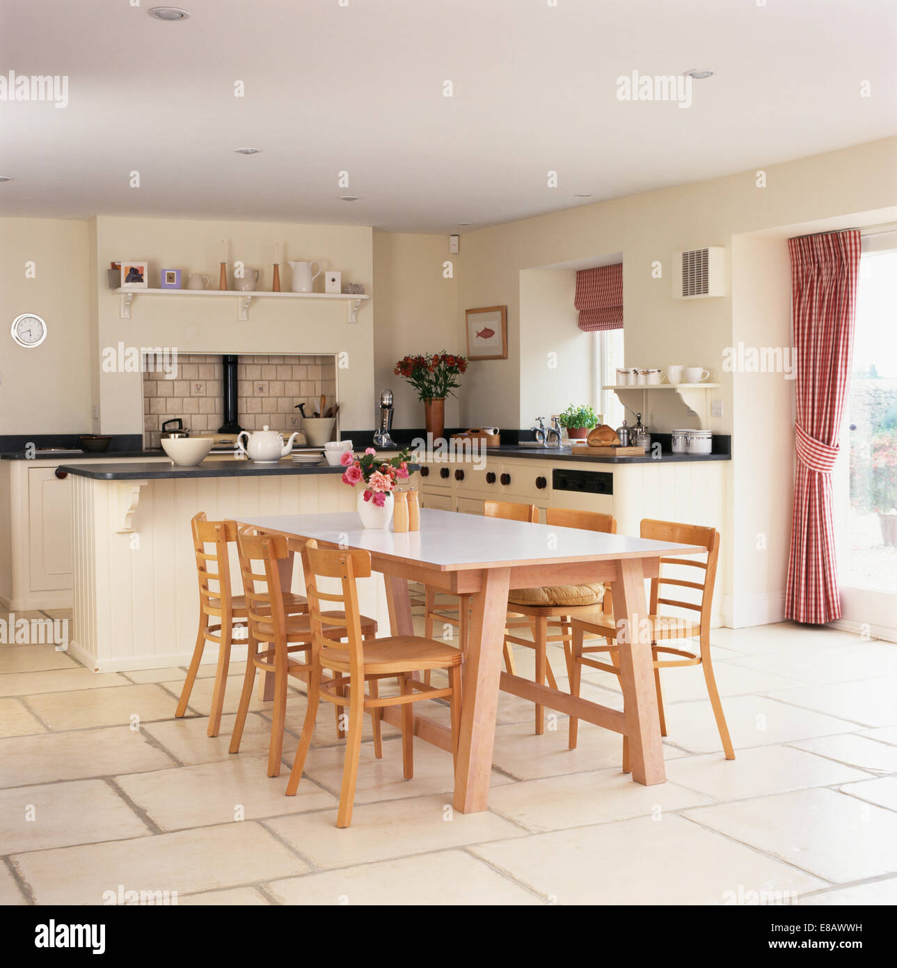 Pale Wood Chairs And Table In Modern Kitchen Dining Room With Limestone  Tiled Floor