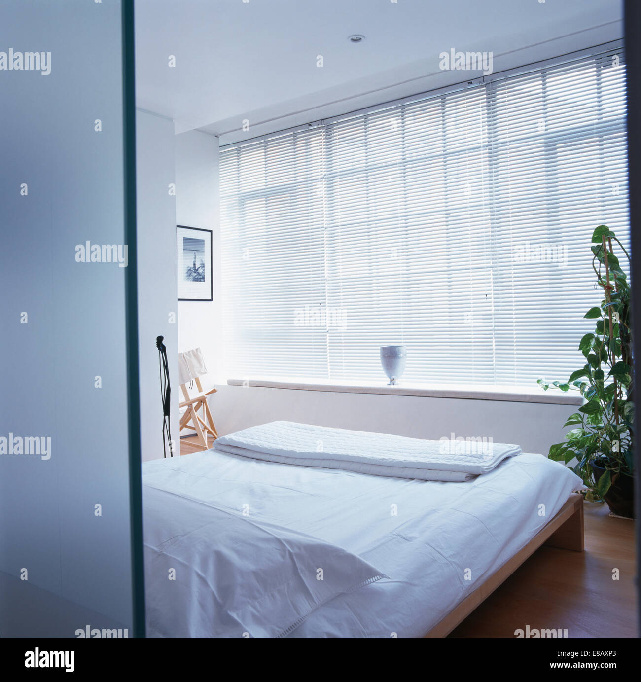 White linen blinds on window above sink in white Portuguese ...