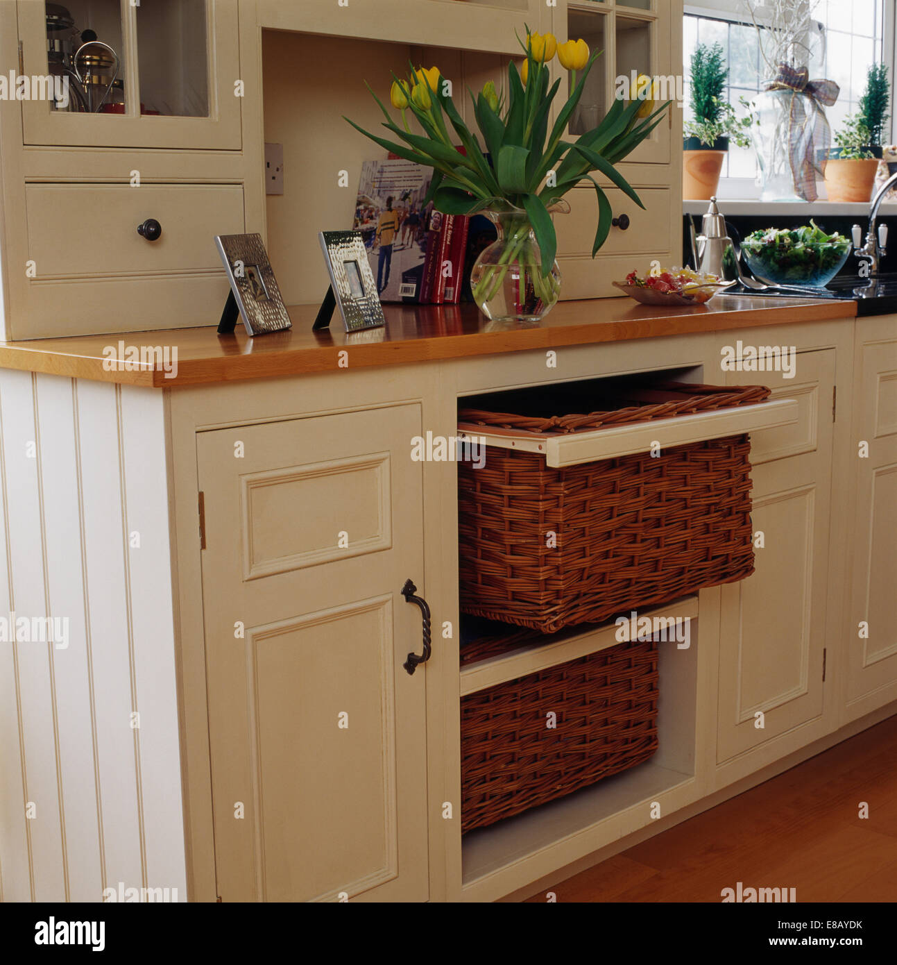 Stock Photo Wicker Storage Baskets On Shelving In Cream Painted Fitted Unit In Country Kitchen