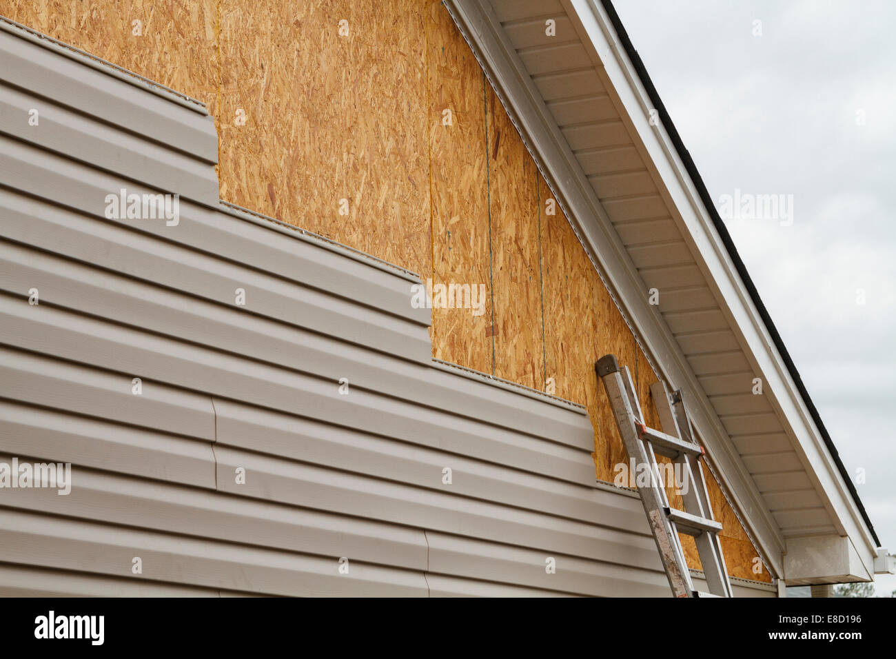 New Beige Vinyl Siding Being Installed Over An Osb Oriented Strand Stock Photo Royalty Free