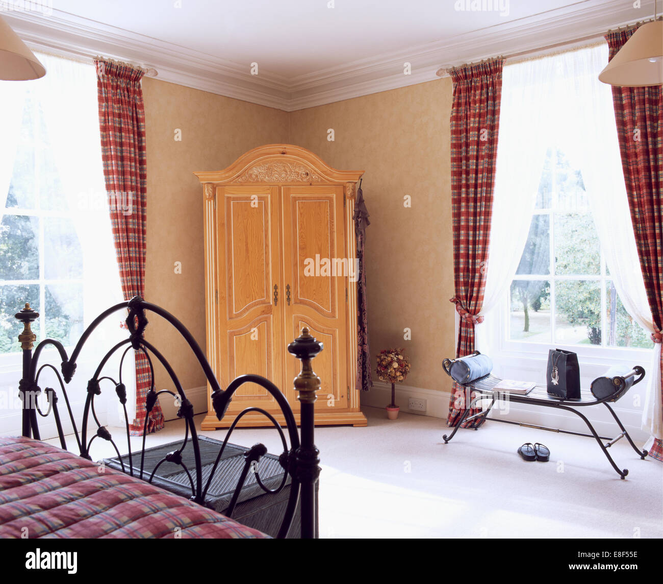 Pine Wardrobe In Corner Of Bedroom With Tartan And White Voile Curtains On  The Windows