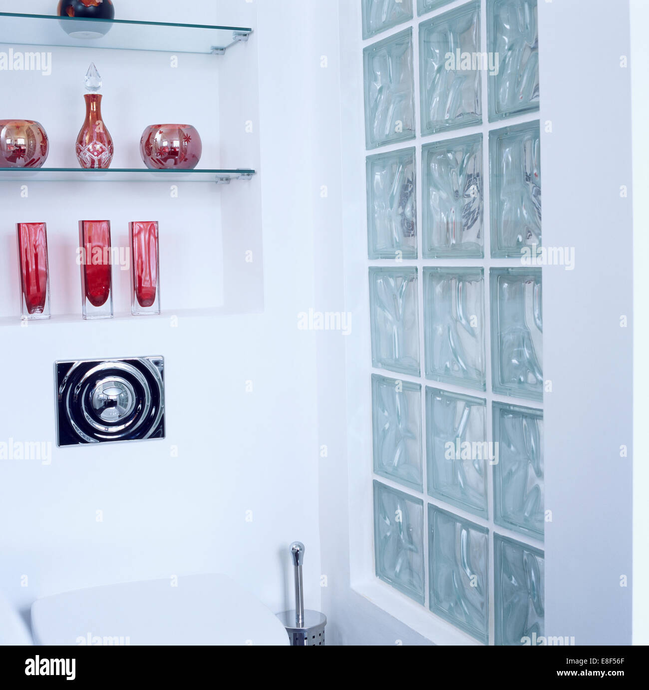 Glass bricks in bathroom - Collection Of Colorful Glassware On Glass Shelves In Alcove Beside Glass Brick Wall In Modern Bathroom