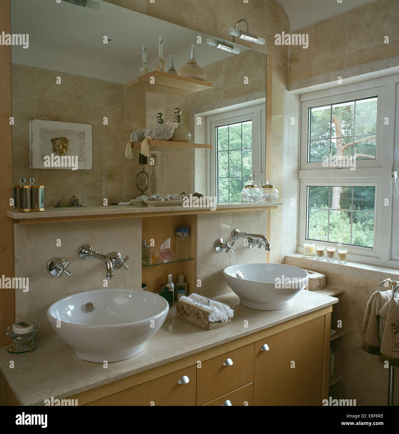 Double Bowl Basins On Vanity Unit Below Mirror And Shelf In Country Bathroom