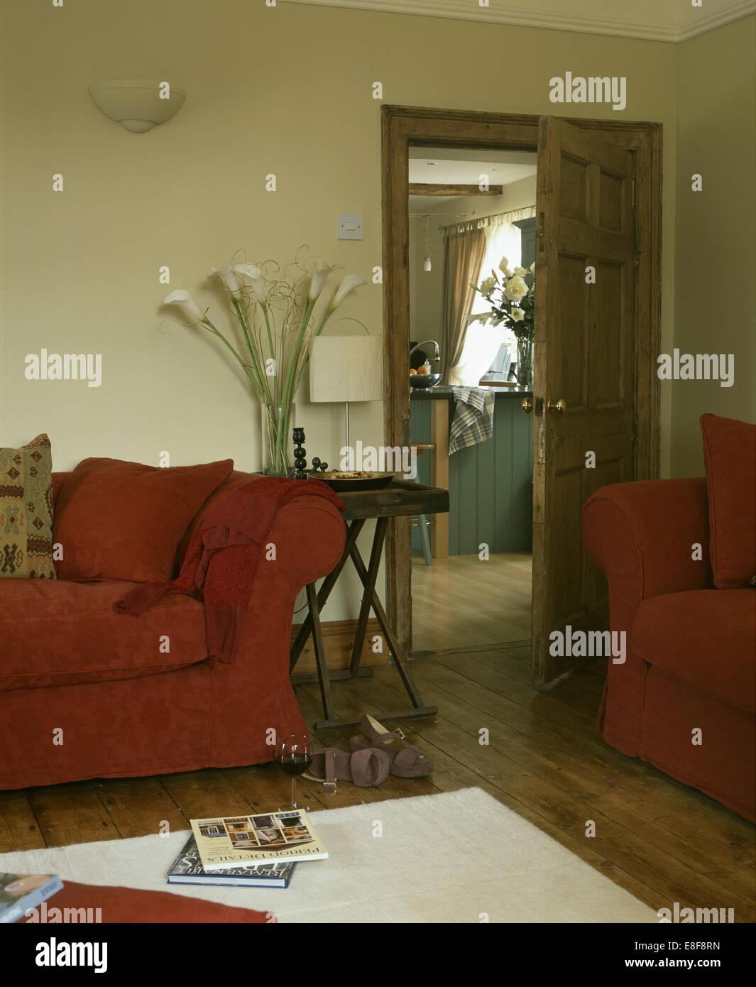 Terracotta Sofas In Cream Living Room With Vase Of Arum
