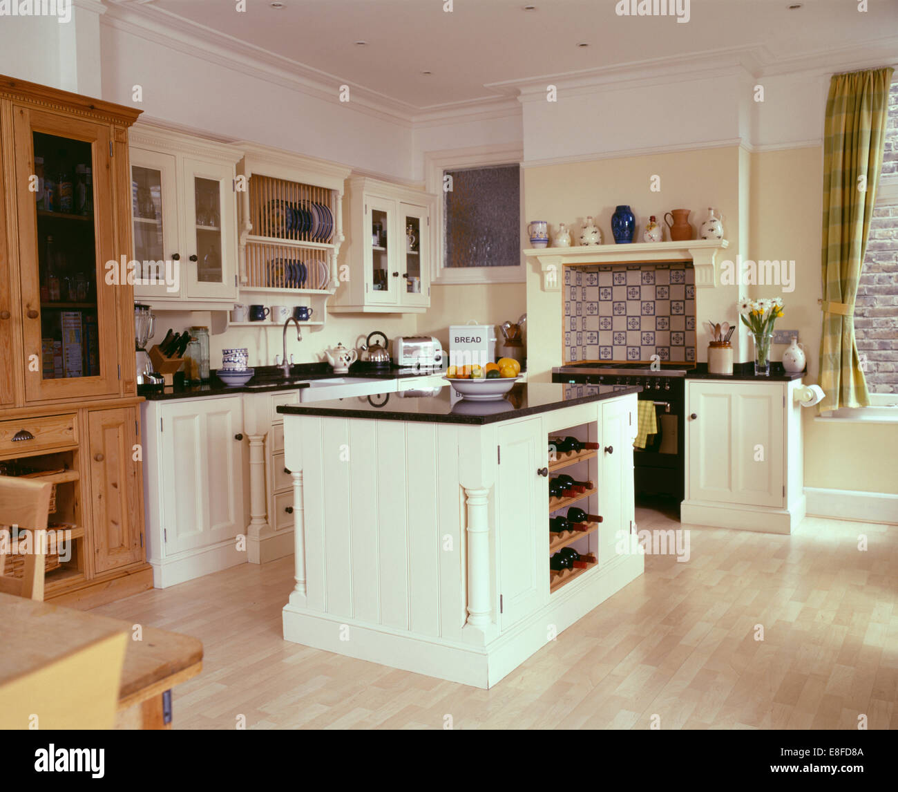 Island Units For Kitchens: Granite-topped Island Unit In Cream Townhouse Kitchen With