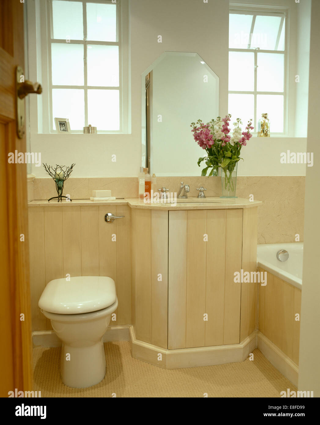 Modern bathroom toilet - Modern Bathroom Toilet Beside Basin In Vanity Unit With Pale Wood Tongue Groove Paneling