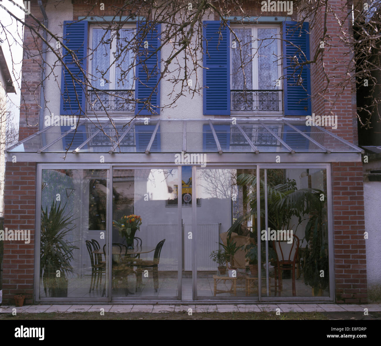 Sliding glass doors on modern conservatory extension on for Conservatory sliding doors