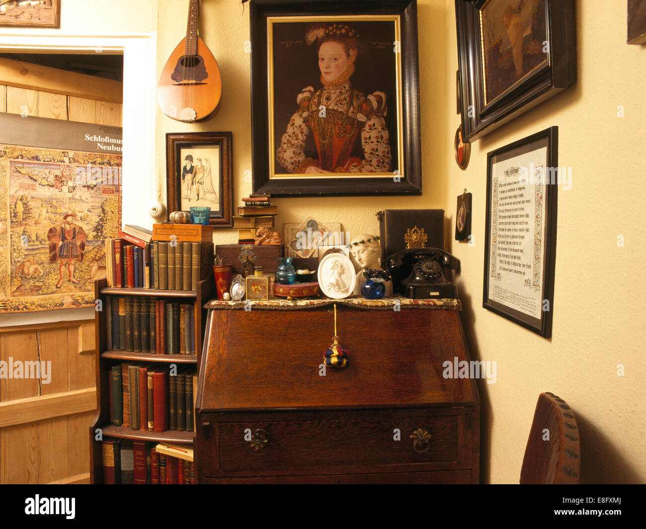 Small bookcase beside bureau with eclectic collection of objects