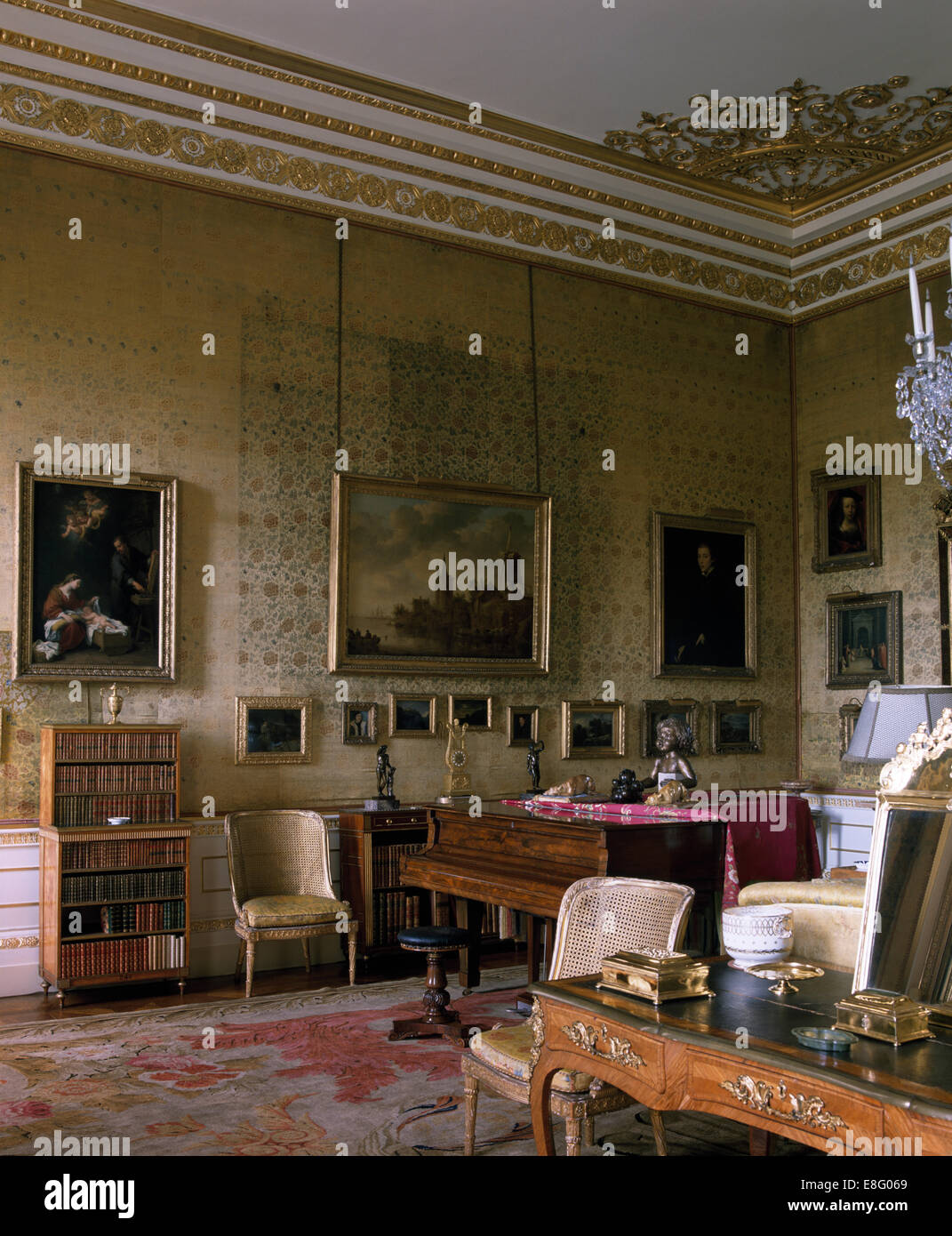 Gilt Cornice And Antique Piano In Drawing Room Of Stately